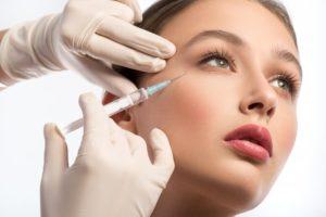woman Botox needle