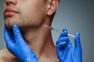a person receiving a BOTOX injection in their TMJ