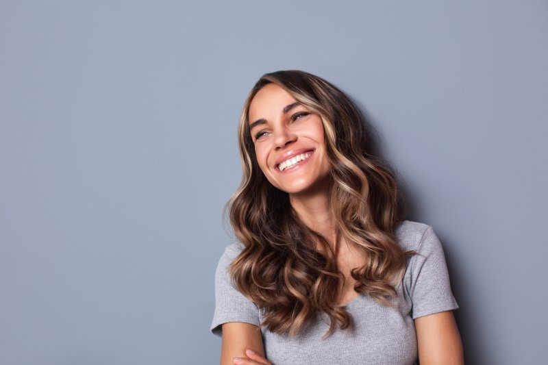 Woman smiling with white, healthy teeth